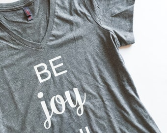 Be Joy FUL v-neck graphic shirt. T-shirt for women with signature be joyful design. Cute quote shirt for woman.