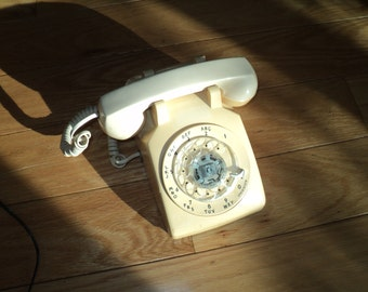 Vintage Boring Beige Rotary Telephone with matching beige cord, An AT&T, Western Electric Brand in Vintage Condition with developed patina