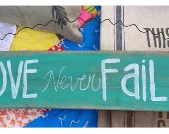 """Bailey's """"Love Never Fails"""" Sign"""