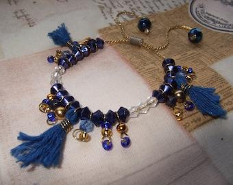 Adjustable beaded tassel charm bracelet