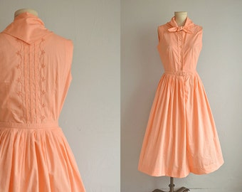 Vintage 1950s Dress / 1950s Peach Embroidered Pleated Skirt Sundress with Scarf Neck and Belt