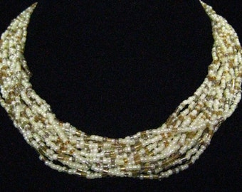 CLEARANCE 18 Strand Torsade  c. 1980's. Creamy Pearl Seed Beads, Citrine Glass and Metalic Lined Clear Glass Seed Beads.  Silver Findings.