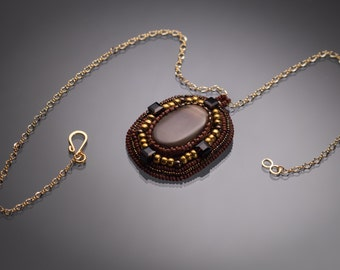 Agate Cabochon surrounded by Gold and Brown bead embroidery
