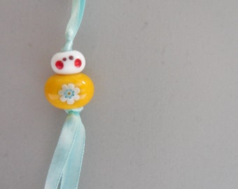 Good luck charm - millefiori flower - yellow and light blue - free gift pouch