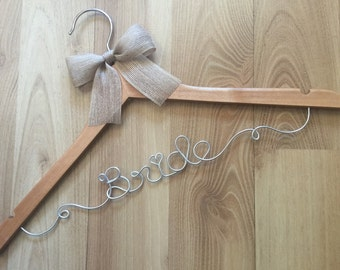 Rustic BRIDE faux hessian/jute/burlap bow wedding hangers. Perfect to compliment the country,l and rustic themed wedding day & bridal shower