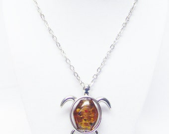 "Brown Speckle Oval Glass Bead inside Silver Plated Turtle Pendant Necklace (20"")"