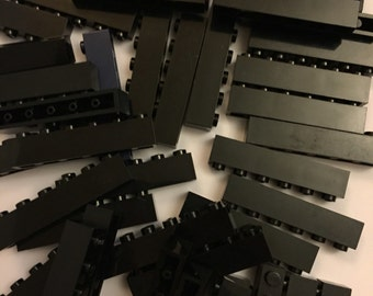 25 black 1x6 Lego bricks