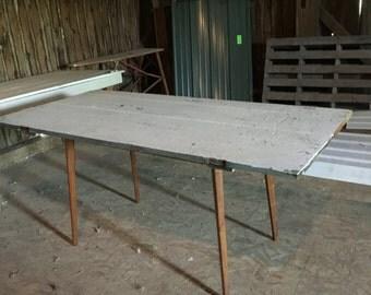 Barn door Danish Modern dining table mash-up chic