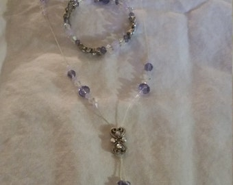 Purple and white beaded necklace and bracelet set