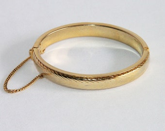 Vintage Shiny Gold Plated Hinged Bangle Bracelet with Embossed Design and Safety Chain 1980's Jewelry