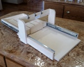 """Drawer type log splitter to cut one 4"""" loaf from a 12"""" x 12"""" slab."""