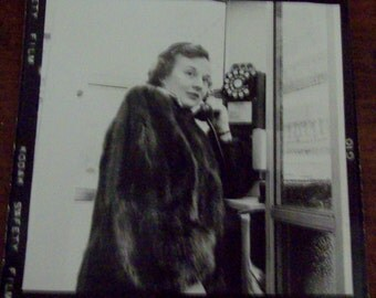 Vintage Black and White Kodak Photograph Lady in Mink Coat on Pay Phone