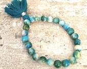 Multicolor teal mountain jade beaded bracelet with teal cotton tassel; mala beads; mala bracelet
