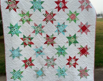 Spinning star christmas quilt