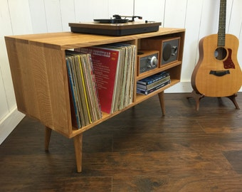 New mid century modern record player console, turntable stereo cabinet with LP album storage. Avail in cherry, white oak or mahogany.