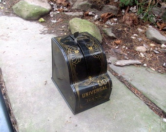 vintage black tin coin bank with gold colored accents, dated 1905, universal three coin bank4