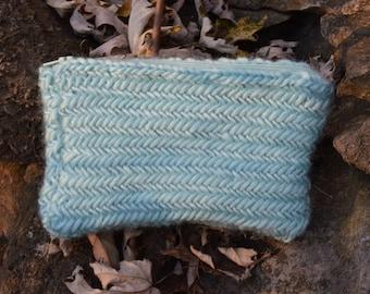 light turquoise herringbone clutch