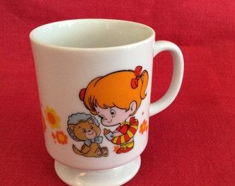 A little girl is...    mug