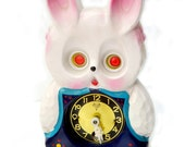 Miken Pendulum Rabbit Clock Moving Eyes Vintage 1960s Wall Hanging Pendulum Clock Pink And Blue Rabbit Windup With Key and Pendulum Japan