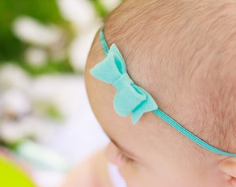 Light Turquoise Bow Headband. Spring Headband. Mini Bow Felt Headband. Newborn Hair Accessories. Tiny Baby Bow. Trending Now. Turquoise