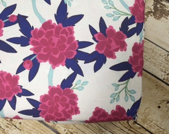 Crib sheet in mint, navy and magenta floral fabric