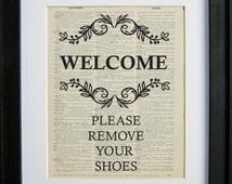 Welcome, Please Remove Your Shoes sign printed on a page from an antique dictionary
