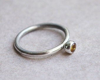 Handmade sterling silver ring with amber