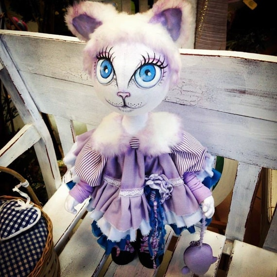 Doll cat face painted in purple color dress. Handcrafted, made with love. A lovely present for her.