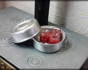 Pot with cherry jam