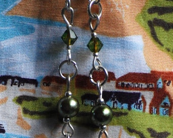 Silver and green dinosaur drop earrings