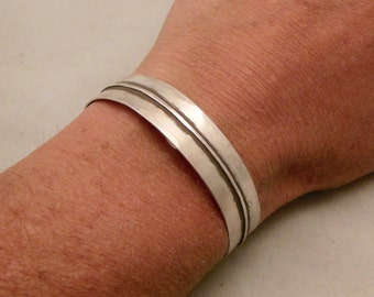 Silver Cuff Bracelet Form Folded and Hammered with an Antique Patina