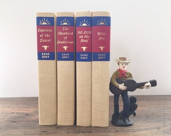 Zane Grey set of 4 • vintage collection • red blue and cream • cowboy • western • decorative books • book bundle