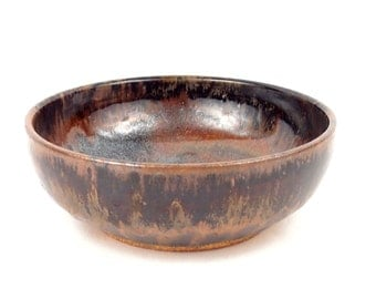 Small bowl in earth tones with rich browns and metallic blacks