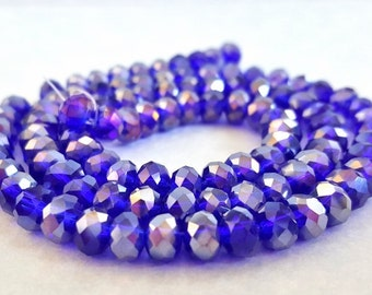 15 Inch Strand of Dark  Blue AB Crystal Beads.  4 X 6mm Rondelle Beads.  100 Beads per Order.  Very Glitzy and Glam!!