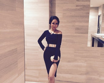 Black off-shoulder knee-length dress with slit