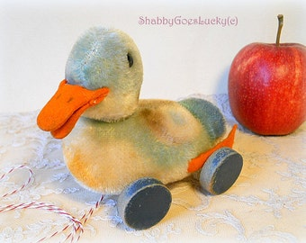 Steiff pull duck, small 4 inch mohair duck with swivel head on eccentric wooden wheels, produced 1954 – 60 only, vintage Steiff collectable