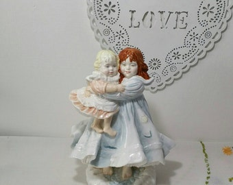 "Royal Worcester Limited edition 1980's NSPCC Collectors figure /  two sisters, one carrying the other, entitled  ""Love"""