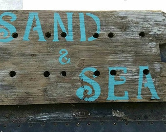 Sand and sea wooden sign