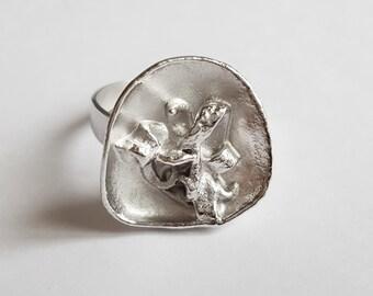 petal ring and ribbons