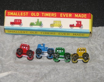 2 miniture car and  sets hand painted NOS 1960's