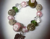 """Arm Candy. """"The Ivy"""" AKA inspired charm/beaded bracelet . Pink and Green. Alpha Kappa Alpha"""