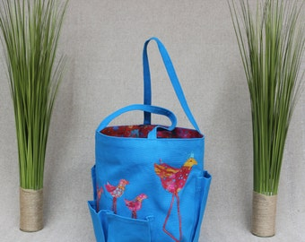 Garden bag in bright blue canvas with whimsical birds