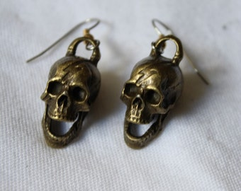 "Dangling earrings. ""Skull Bolt Heads"""