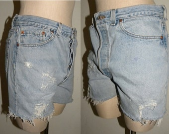 """Vintage Levi's 501 shorts  / 501s / cut offs / daisy dukes / made USA / destroyed distressed / size 34 / measured 30-31"""" at waist"""