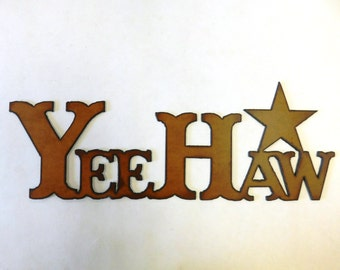 Yeehaw with Star sign made out of rusted metal