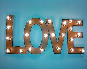 Love Marquee lighted sign made out of rusted metal