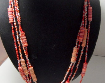 """Long strands of beaded orange &  ivory beads necklace.  Can be doubled or tripled. 116"""""""