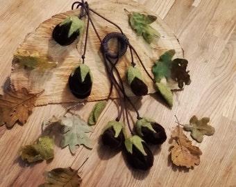 game/necklace holder with felt flowers is velvet.  nickelfree necklace