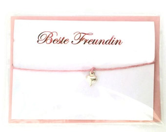 "Bracelet, Friendship Bracelet, and ""Best friend"" card envelope"
