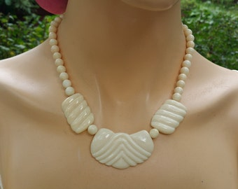 Lovely ivory  tone  Lucite statement necklace.  Great vintage piece perfect with jeans and a tee.